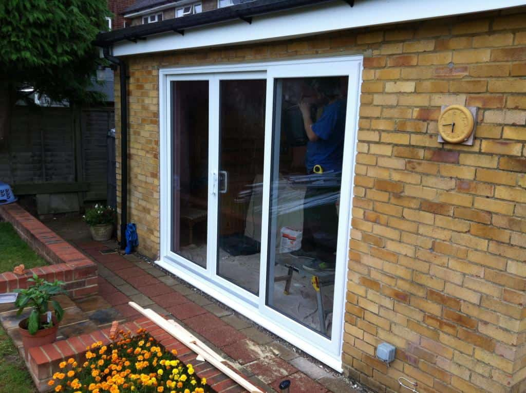 Triple doors triple track frameless panel sliding doors for Outside sliding glass doors
