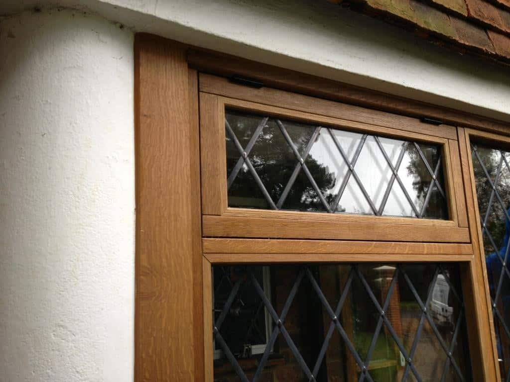 Solid Oak with clear touchened glass and diamond leaded lights