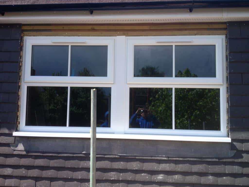 Dormer loft conversion new upvc windows Reigate Surrey