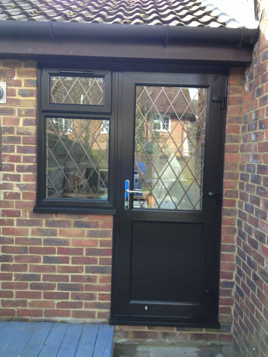Brown black upvc windows gallery dorking glass for Brown upvc door