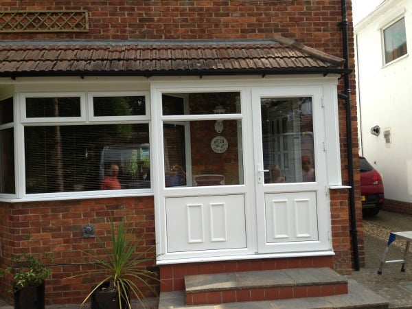 White uPVC Swiftframe profile.  Bevelled frame and beading.  White uPVC decorative panels in lower sections and clear toughened glass in the upper sections.