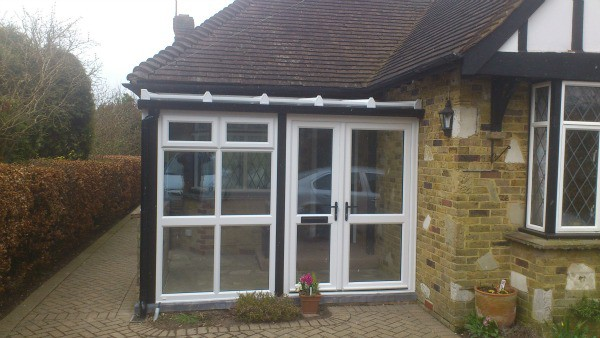 White uPVC conservatory with black uPVC trims to imitate original timber