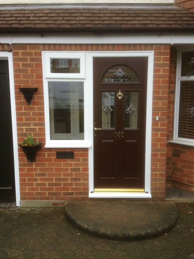 Double glazing dorking new grp composite front door for Entry door with side windows