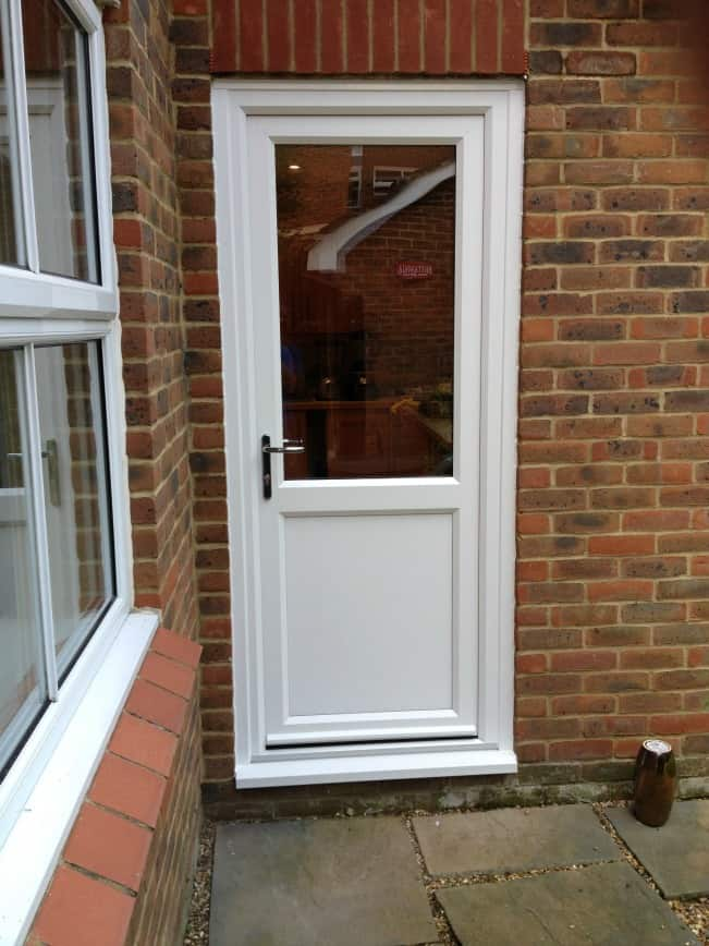 White Liniar uPVC door with multi-point locks operated by chrome leverlever handles.