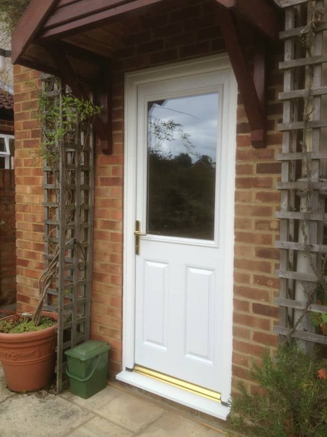 White in and out GRP composite back door with gold colour furniture
