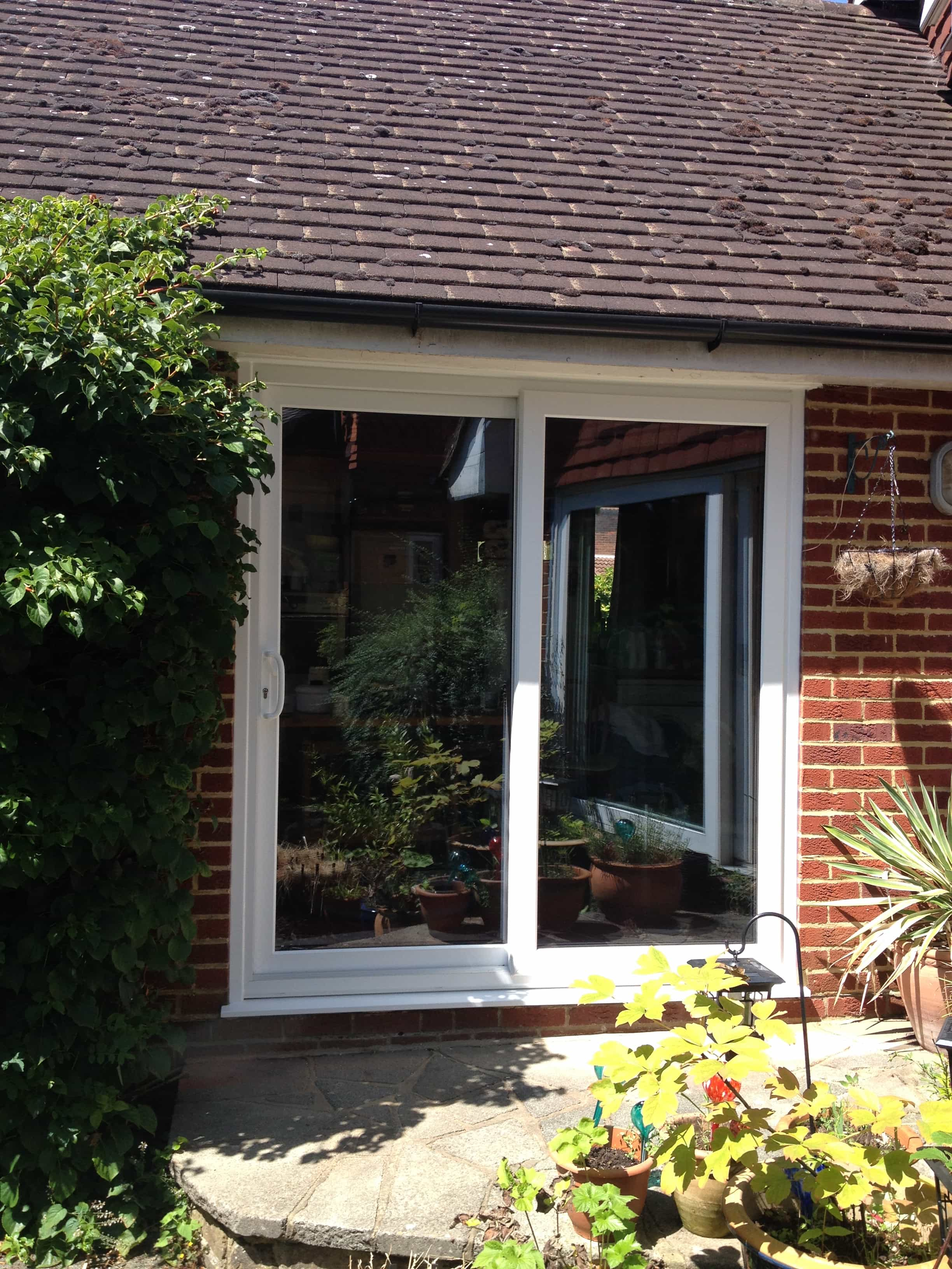 Patio doors in esher surrey gumtree bi folding patio for Double entry patio doors