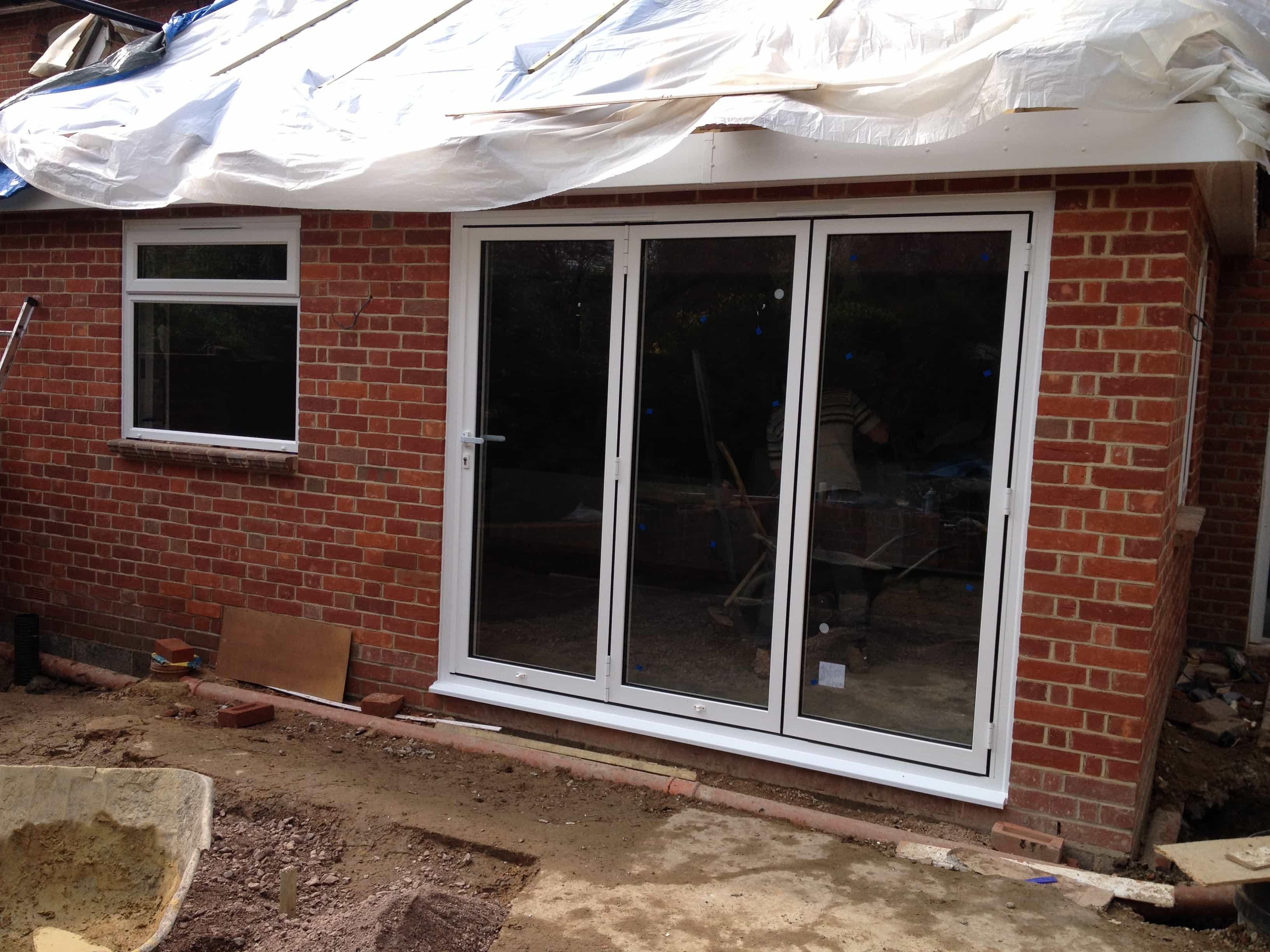 Bi folding doors dorking glass patio doors french doors for Folding french patio doors